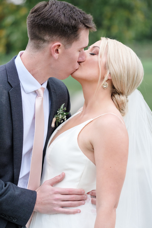 Bride & Groom embrace at Rockford Bank and Trust Pavilion.