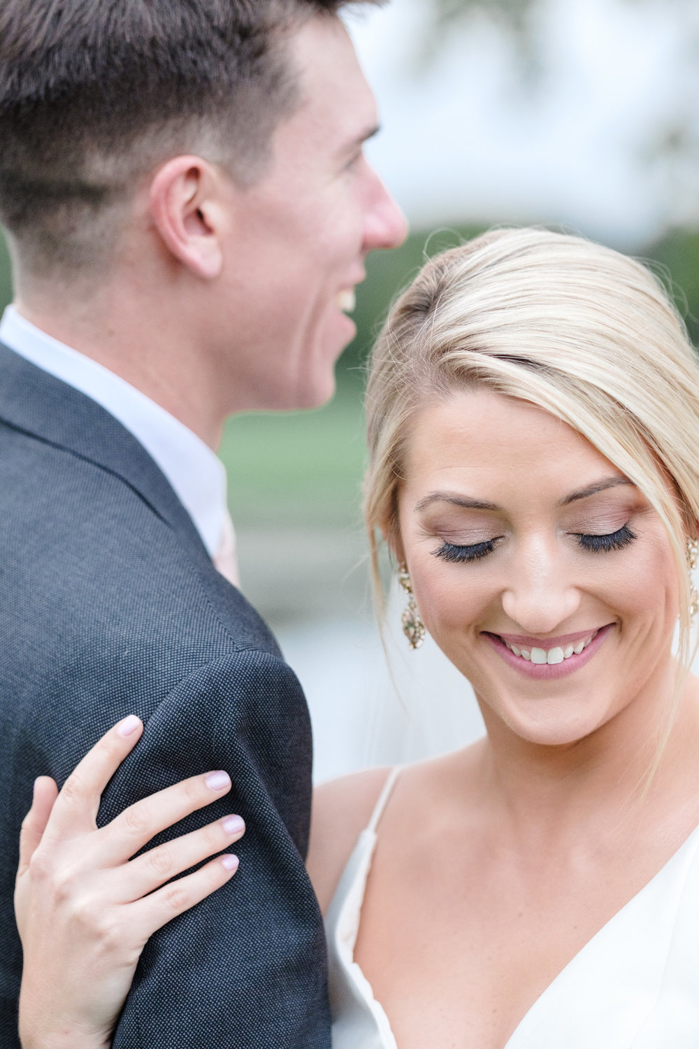 Couple embrace and laugh at Rockford Bank and Trust Pavilion.
