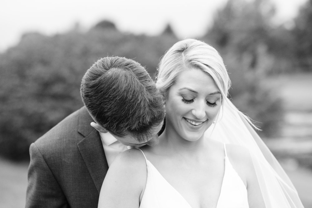 lovingly embrace and kiss on the neck at Rockford Bank and Trust Pavilion.