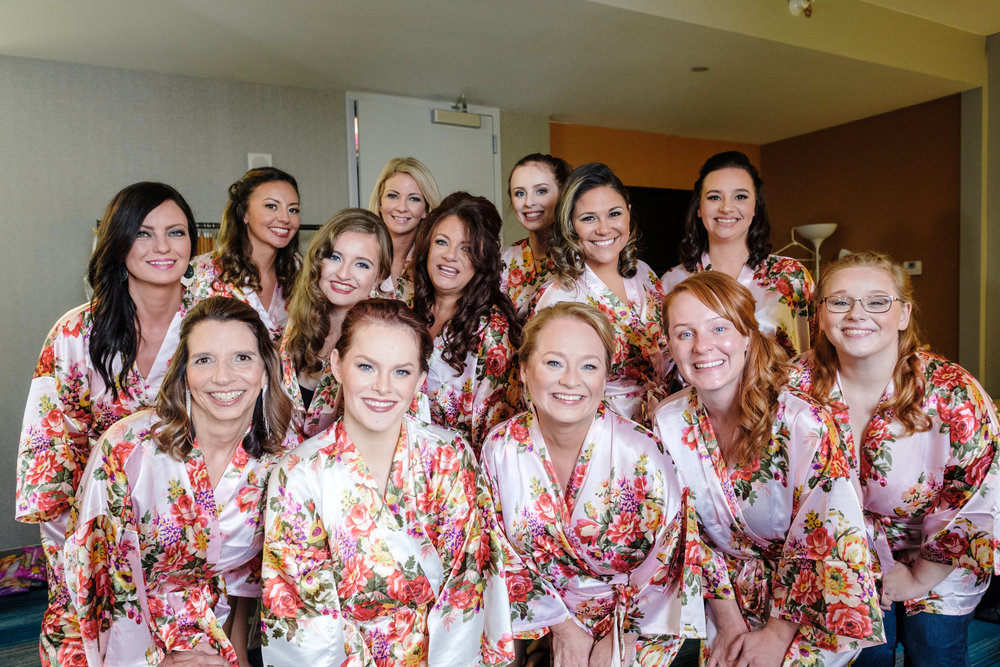bride and bridesmaids in silk robes before cog hill wedding