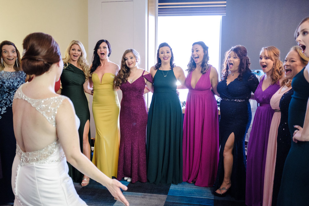 brides reveal to all of her bridesmaids.