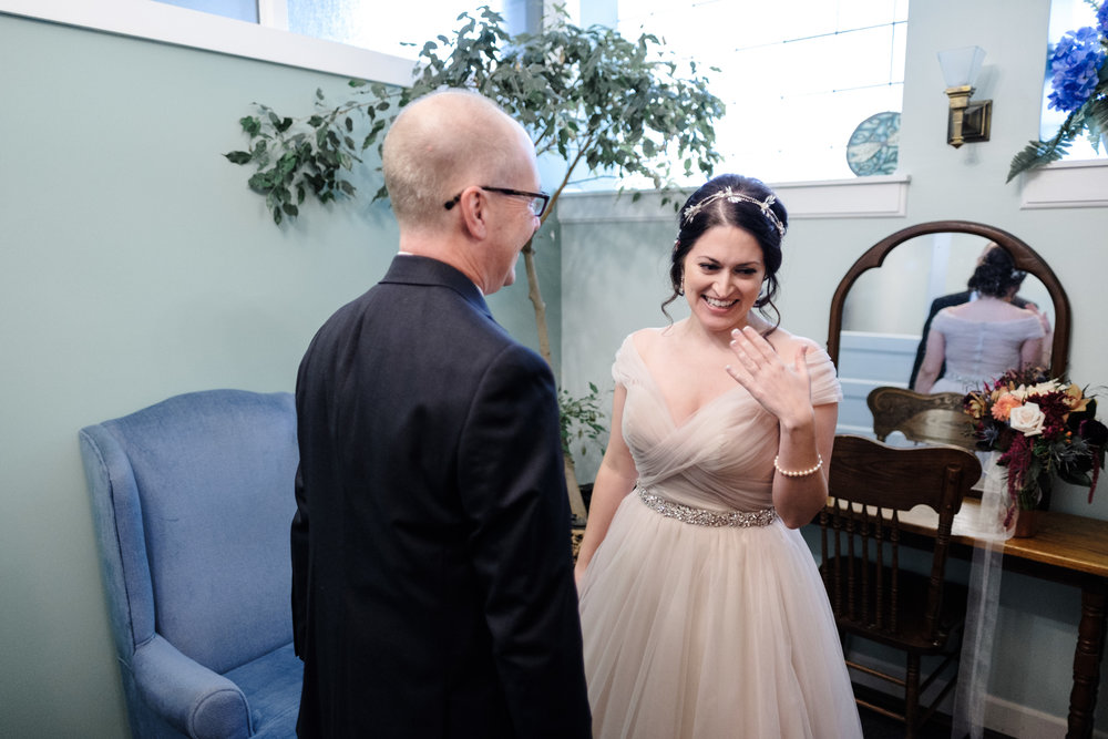 Bride smiles with her father by rockford wedding photographer b. adams photography