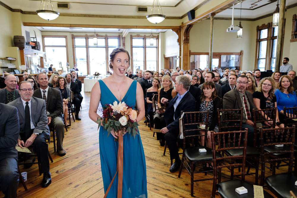 Great hall entrance by bridesmaids in blue dresses at their wisconsin wedding by rockford wedding photographer b. adams photography