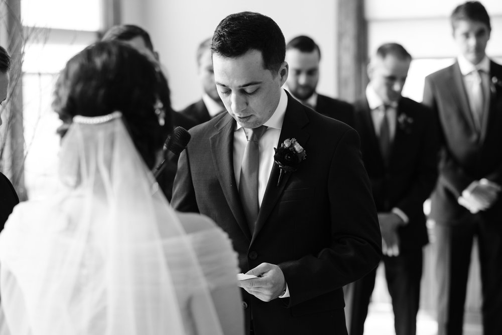 groom tears up while saying his vows to his wisconsin bride