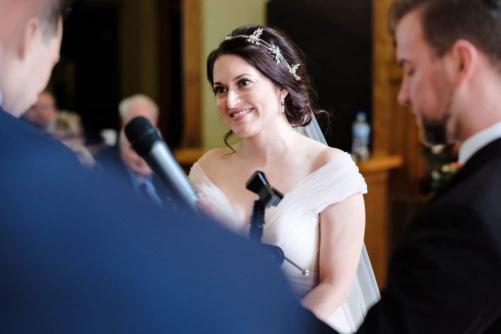 bride tears up during grooms vows at pabst best place fall wedding by rockford wedding photographer.