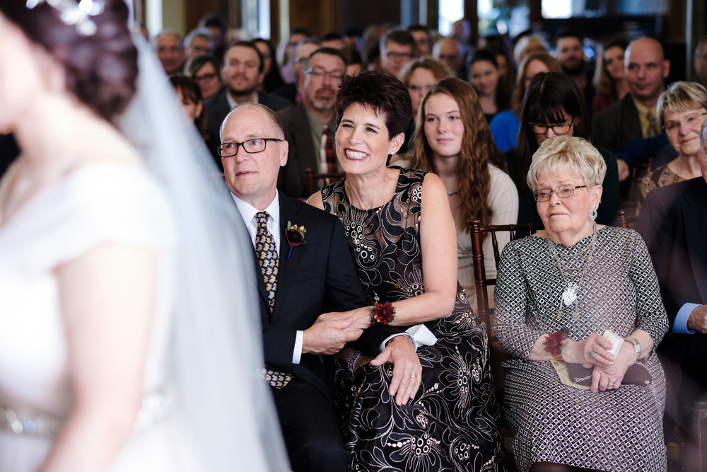 brides parents candidly cry as their daughter marries