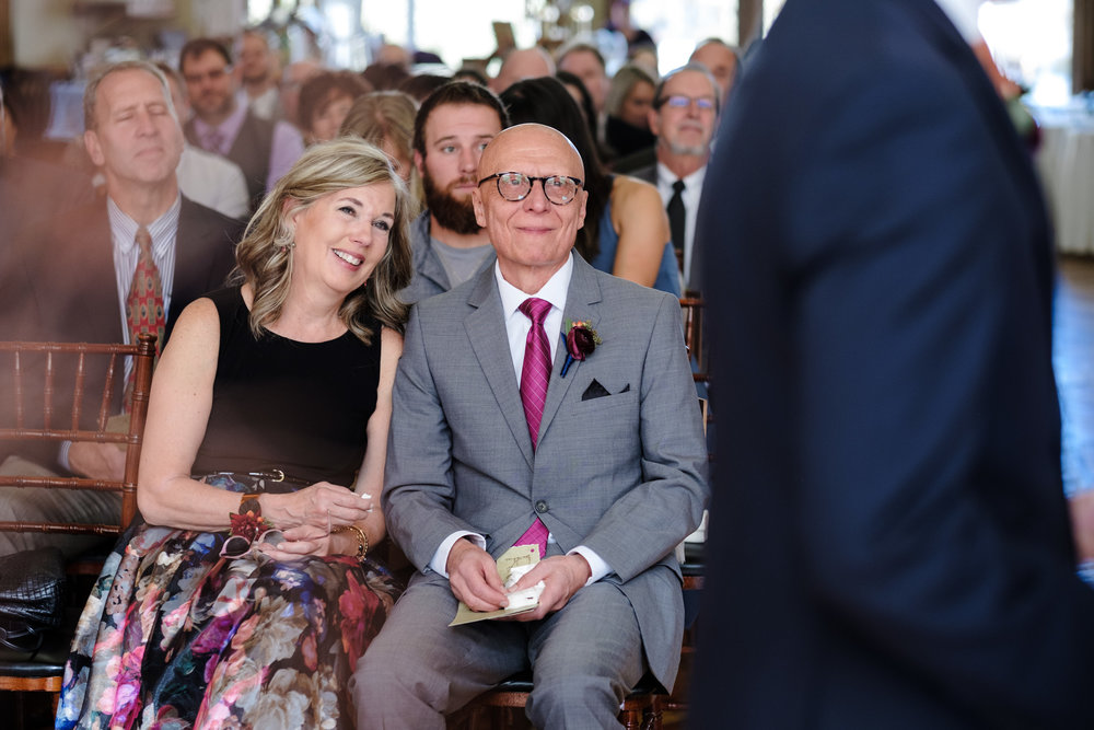 parents of the groom cry as they watch their son get married in milwaukee wisconsin