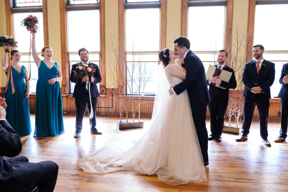 blue suit, orange it fall wisconsin wedding in milwaukee by rockford wedding photographer first kiss