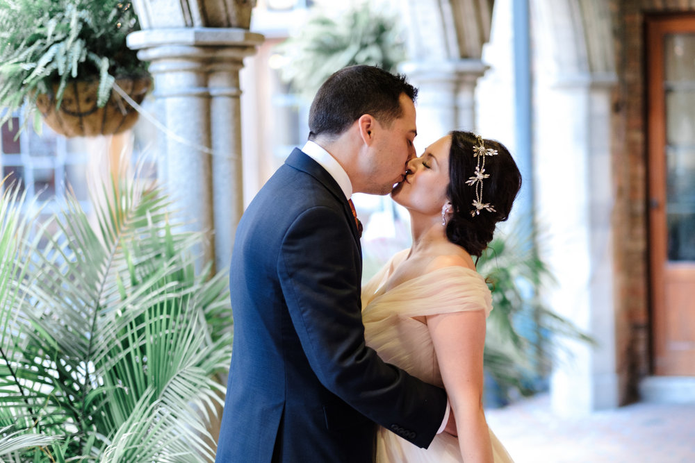 elegant and candid kiss between bride and groom at milwaukee wedding outdoor in october wisconsin and rockford wedding photgoraphy