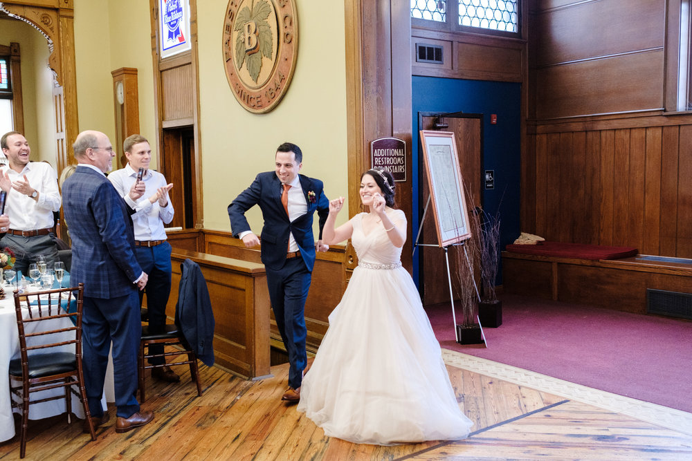 bride and groom make entrance to wedding reception