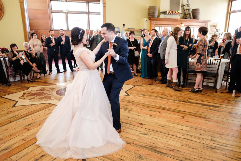 natural light bride and groom first dance blue suit, rockford wedding photographer, milwaukee wedding.