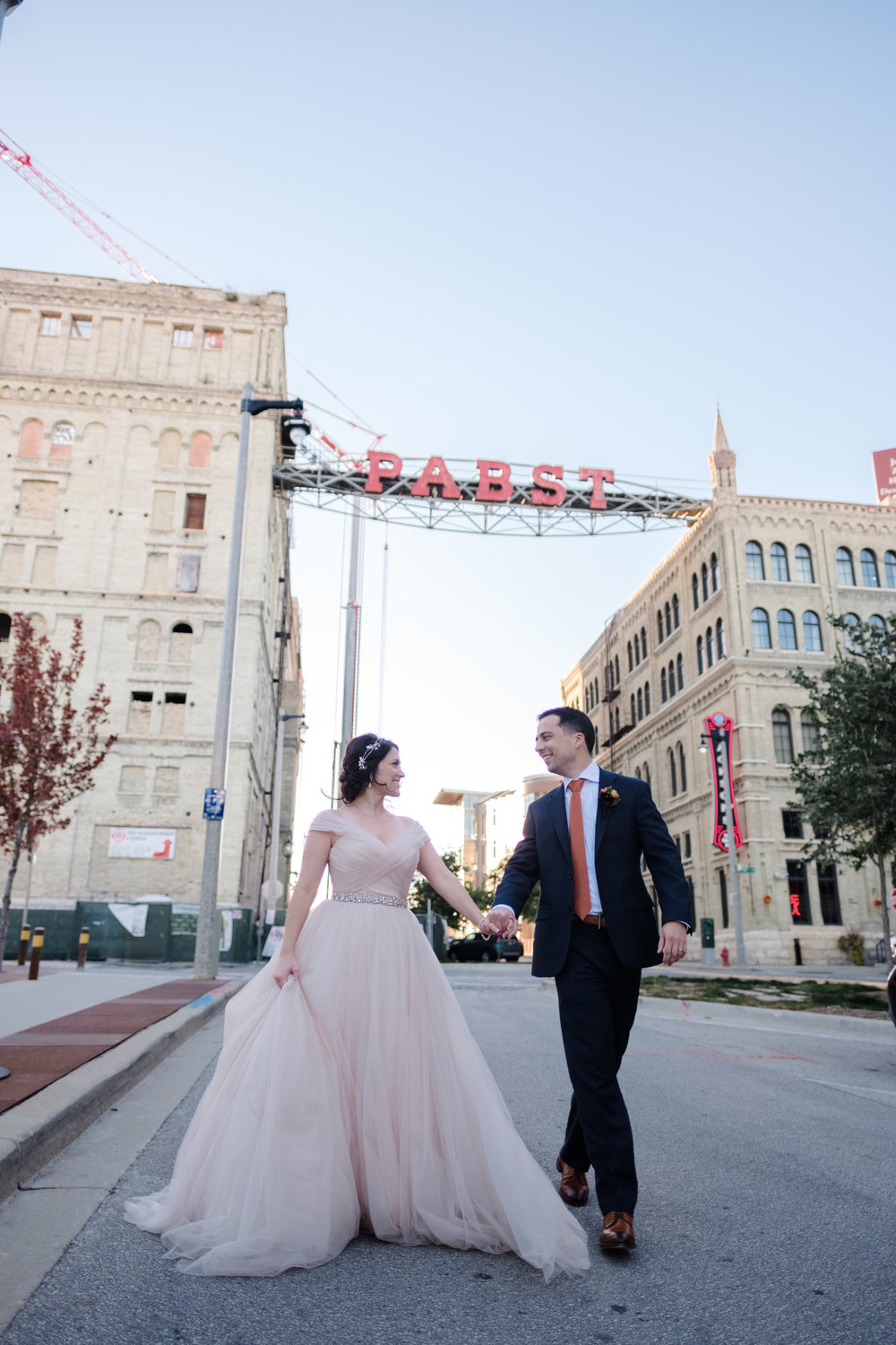 Rockford Wedding Couple under Pabst Sign in MIlwaukee wisconsin.