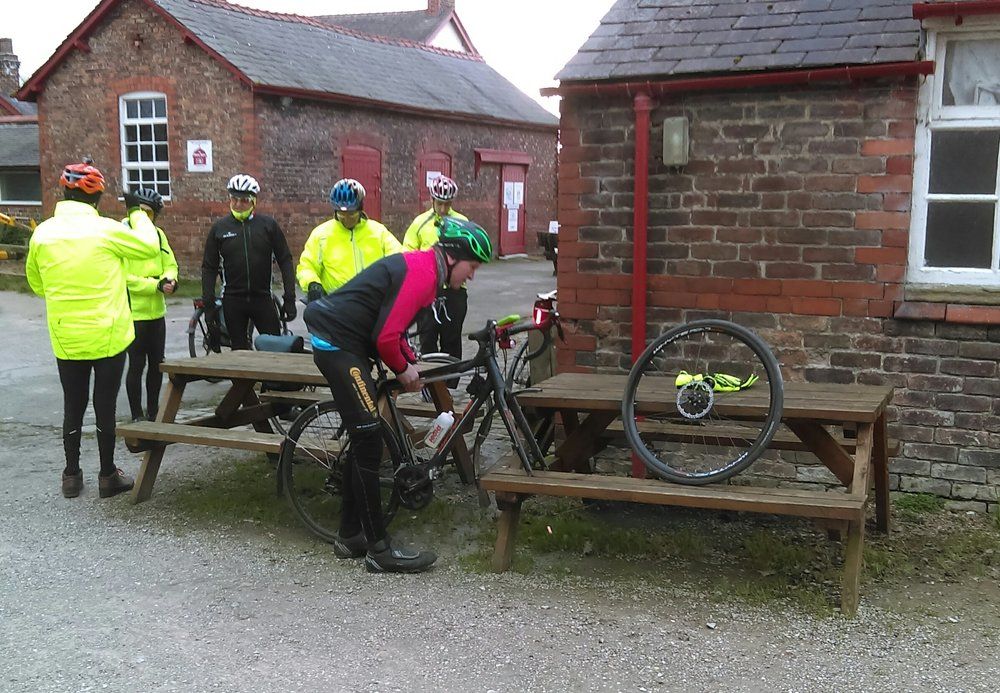 Action shot of Phil fixing his puncture!