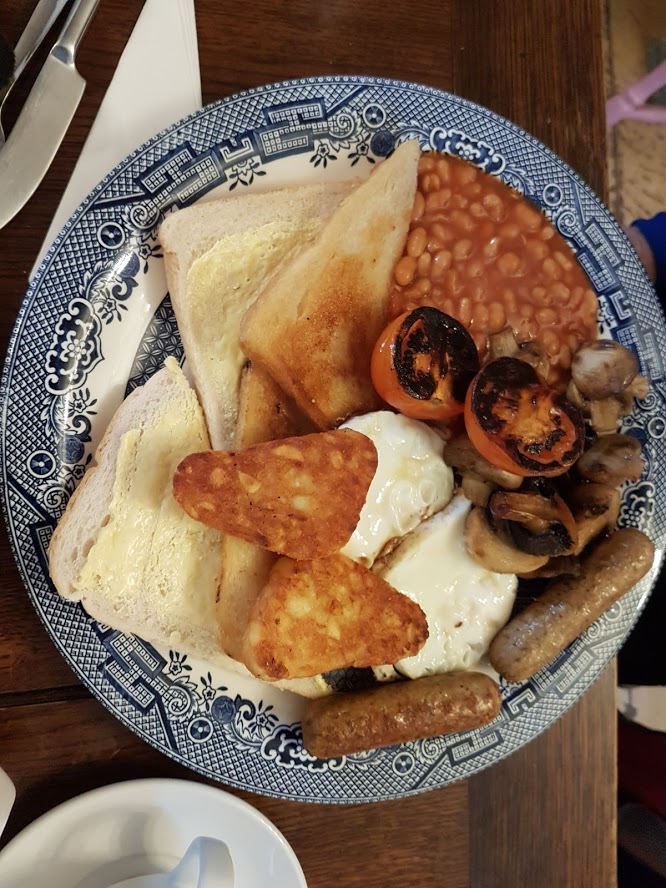 Vegetarian all-day breakfast, so named since it would take all day to eat it. Note the fried bread  and  the bread and butter. Who ordered this? The next picture reveals the truth.