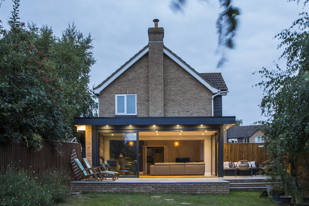Infill Extension Between Detached House And Garage To Provide Open Plan Kitchen Dining Room Garden