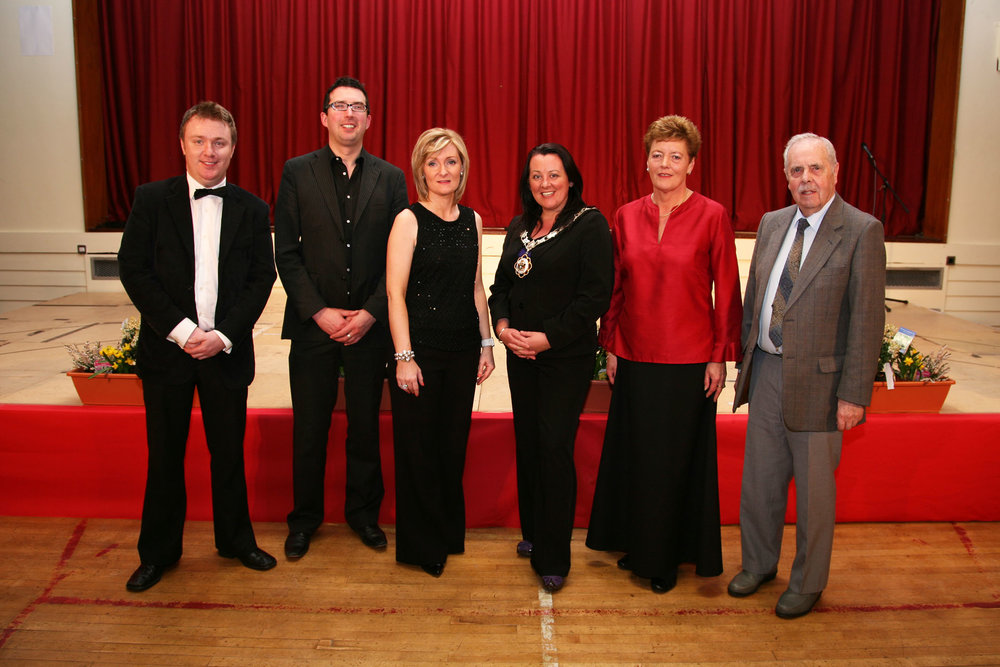 Left to Right; Richard Yarr - Compere, Darren Baird - Accompanist, Sheelagh Greer - Director of Music, Paula Bradley - Mayor of Newtownabbey Borough Council, Barbara Lowry - Choir Chairperson & Mr GCG Millar - Choir President