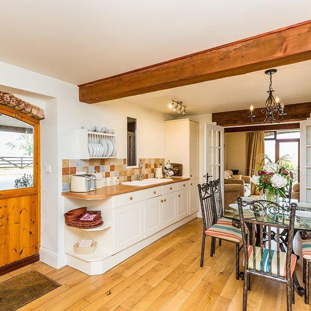 The Barn is a great family home from home #holidaycottage with spacious living areas, en-suite bathrooms and a fantastic dining kitchen. The large covered terrace is perfect for summer evenings sipping wine with views over our #organic farm. #selfcatering #LincsWolds