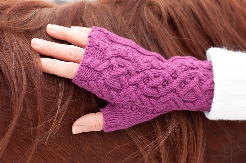 Intertwined Fingerless Mitts - by Nancy JungThese lovely fingerless mitts have wonderful detail and a unique cabled ribbing. While being such a soft yarn, our Embrace 100% Tibetan yak down also has excellent stitch definition, making it an excellent choice for cables.