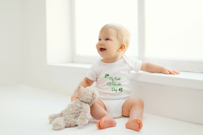 1_Cute-smiling-baby-with-teddy-bear-toy-home-in-room1.jpg