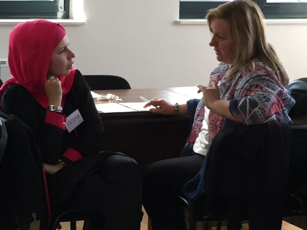 two BiH facilitators discussing.JPG