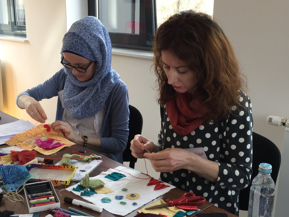 two facilitators sewing.JPG