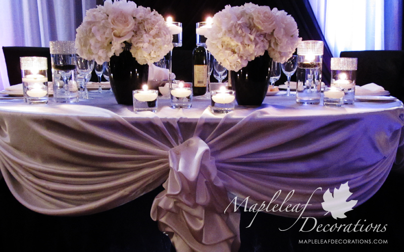 toronto-wedding-hall-decorations-backdrop-and-head-table-decor-la-primavera-banquet-hall-cafe-style-sweetheart-table-black-and-white-ivory-satin-peonies-centrepieces-candles-bling-accessories-montecassino-glass-vases-silver-mesh.jpg