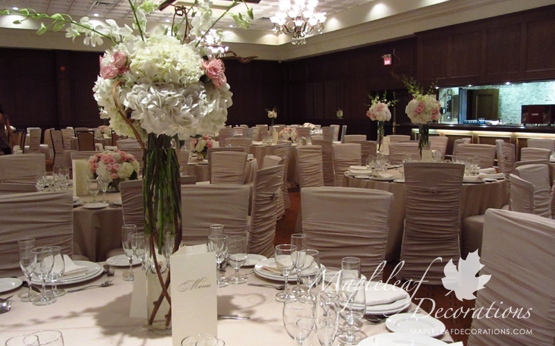 toronto-wedding-reception-hall-decorations-Modern-backdrop-and-head-table-decor-Royal-Ambassador-Embassador-banquet-hall-table-beige-caramel-blush-ivory-satin-flower-centrepieces-Ruched-Chair-Covers-Bling-Brooches-2.jpg
