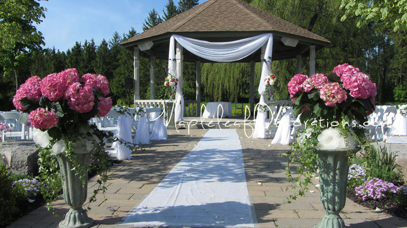 mapleleaf-decorations- wedding-ceremony-decor-gazebo-pew-bows-outdoors-royal_Ambassador.jpg