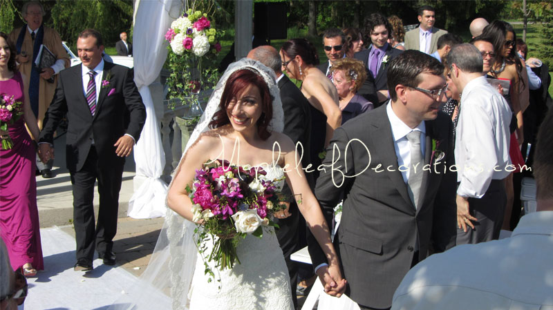 6-bride-and-groom-ceremony-decor-gazebo-pew-bows-outdoors-royal_Ambassador_may202012_teresa_mike.jpg