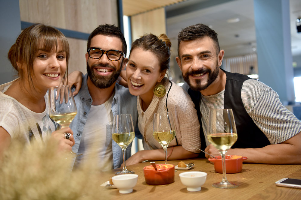 (13.3) A group of friends enjoying white wine.jpg