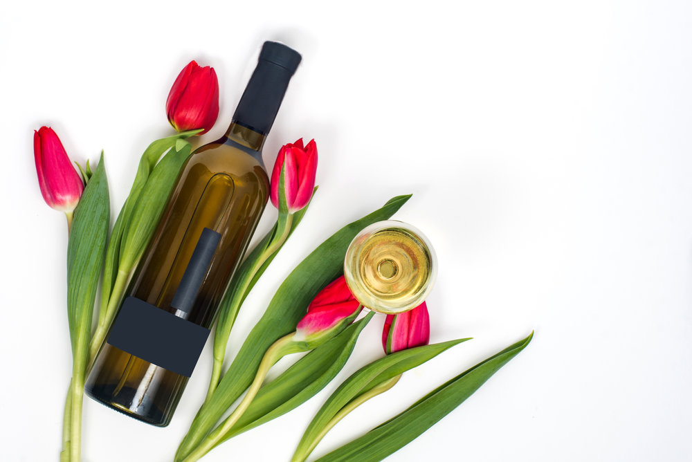 (2.21) Wine bottle surrounded by flowers.jpg
