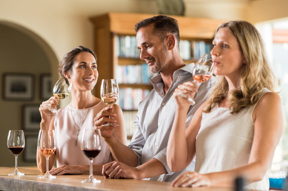 (13.9) Three people tasting different wines.jpg