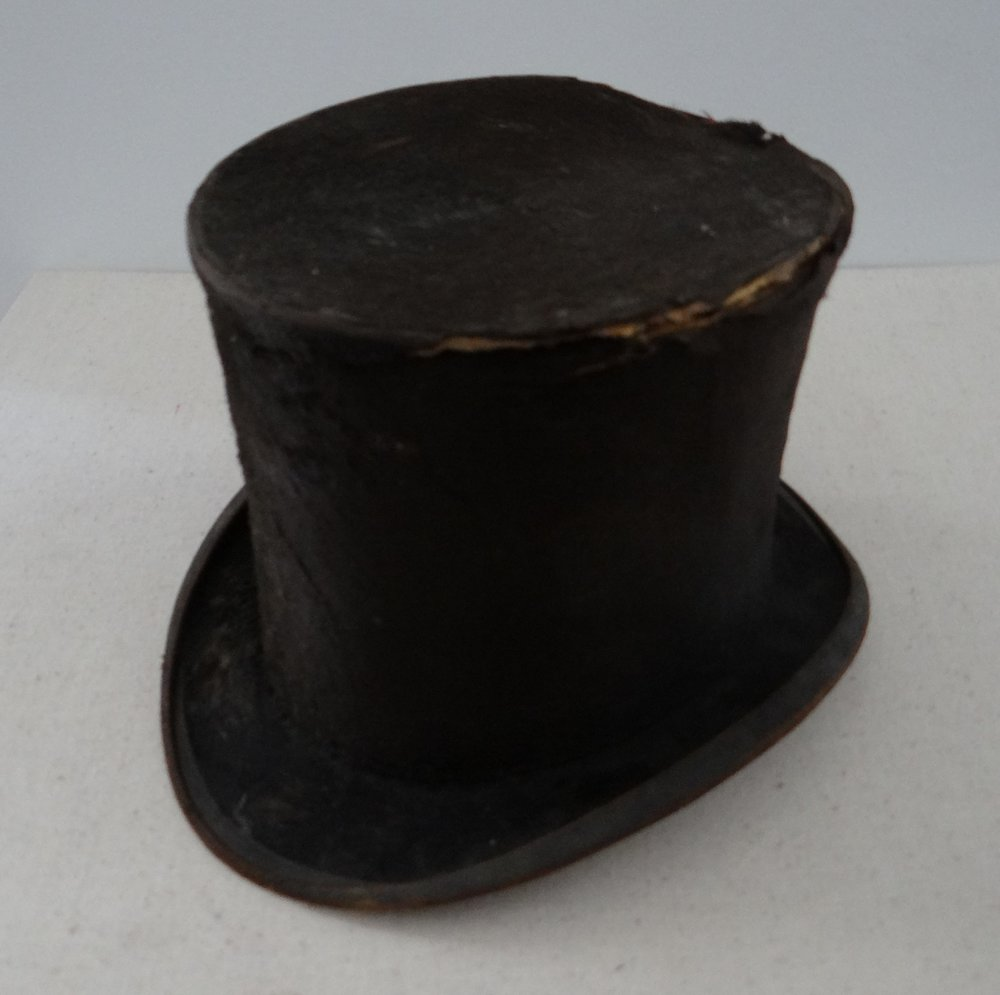 Top Hat. Hilborn, Philadelphia, PA, Inscribed-Trade Mark/Hilborn/218 Market St./Philadelphia, c1860. Robert Kirkbride of Burlington County wore this hat to Abraham Lincoln's inauguration. His descendants moved to Harrison Township and brought the hat here with them as a treasured heirloom. [HTHS: Gift of Mary B. Lippincott]