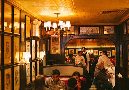 booth and crowd at minetta tavern village manhattan new york city