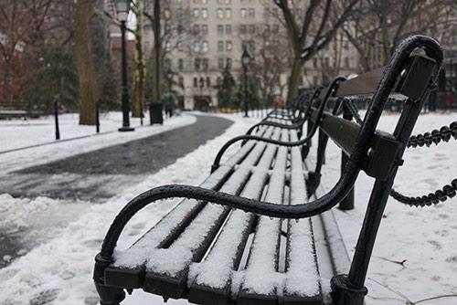 snowy bench in greenwich village in manhattan new york city ny