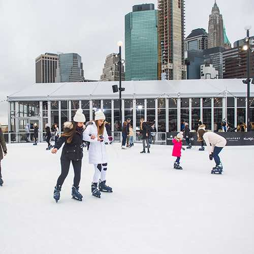 girls skating at winterland rink pier 17 seaport financial district new york city ny