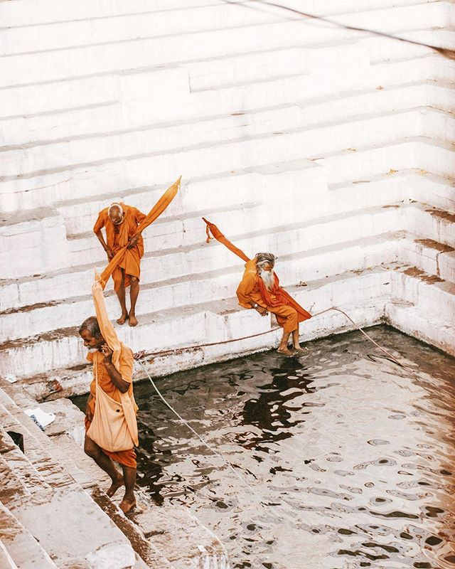 Saffron (a hue of orange) is the most sacred color in Hinduism because it represents fire — and because fire burns impurities, the color ultimately symbolizes purity. Here, 3 saffron-clad Holy men are pictured bathing in Shiva's Pool in Varanasi, India. // 📸: @arnelle // #goodtravels #shiva #sadhu #varanasi #india #travel #travelphotography #thisisindia #visitindia #incredibleindia #hindu #hinduism