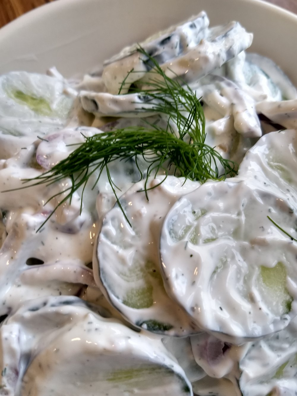 Creamy Cucumber Salad - Crisp and refreshing, this salad consists of English cucumbers, dressed up and ready to go in a smooth and refreshing sour cream sauce.  Fantastic for hot summer days.