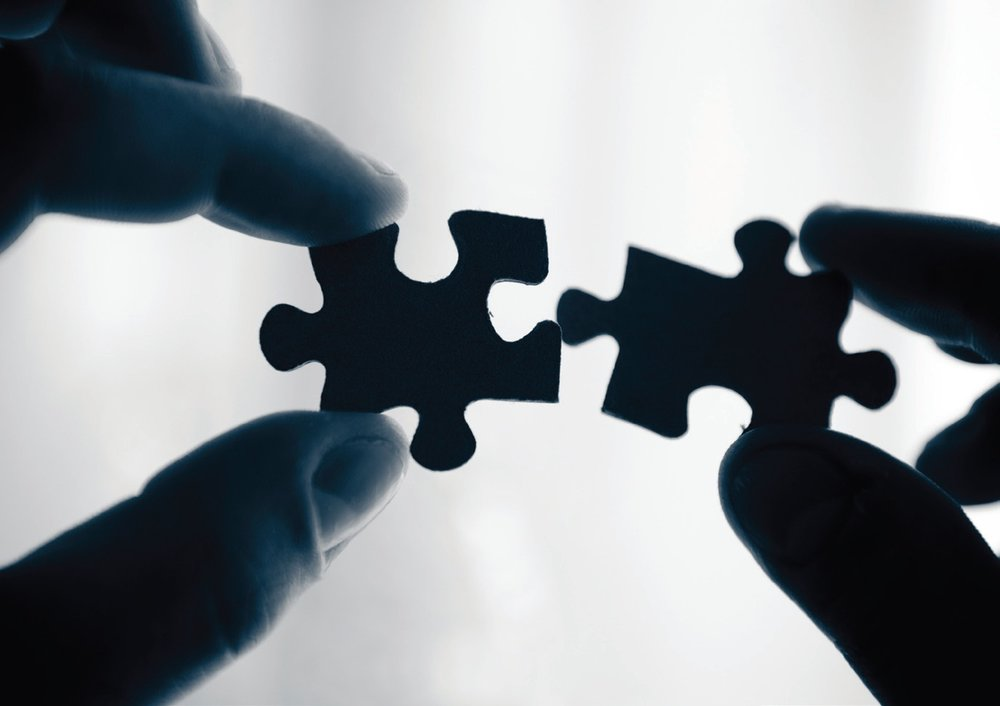 Picture of two puzzle pieces being put together.jpg