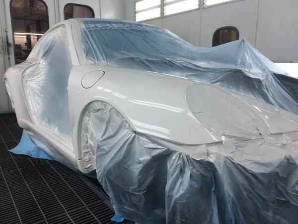 Now that all the panels are repaired and prepped for paint, this race car got moved into our waterborne paint booth and masked for paint. Once we wiped, tacked and sprayed she was looking just as pretty as new.