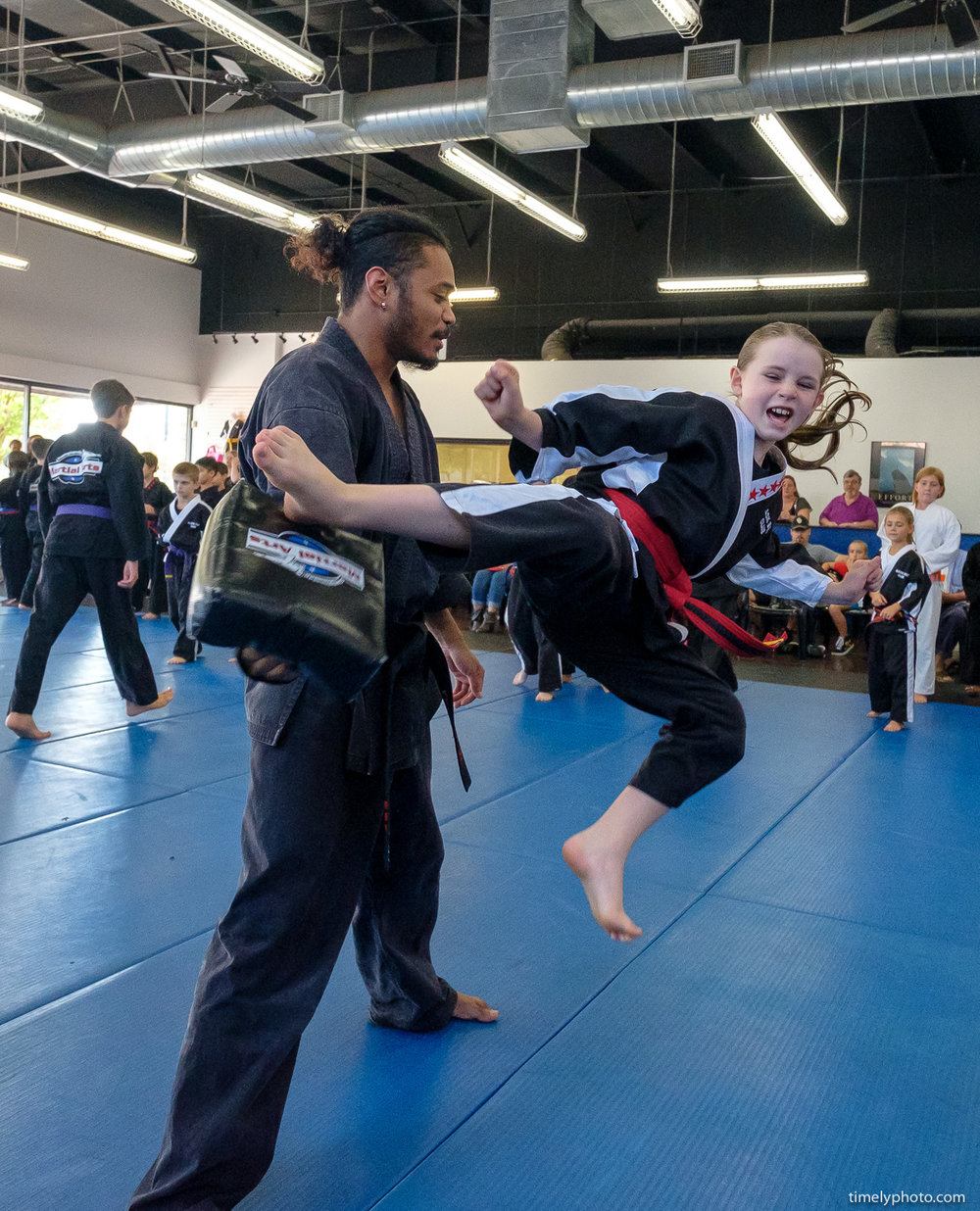 Karate class with child jumping