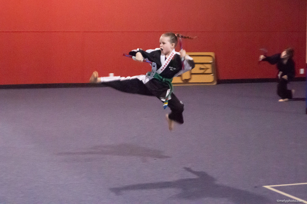 Karate photography with child jumping