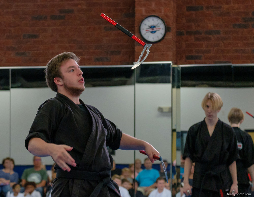 Karate instructor with commas