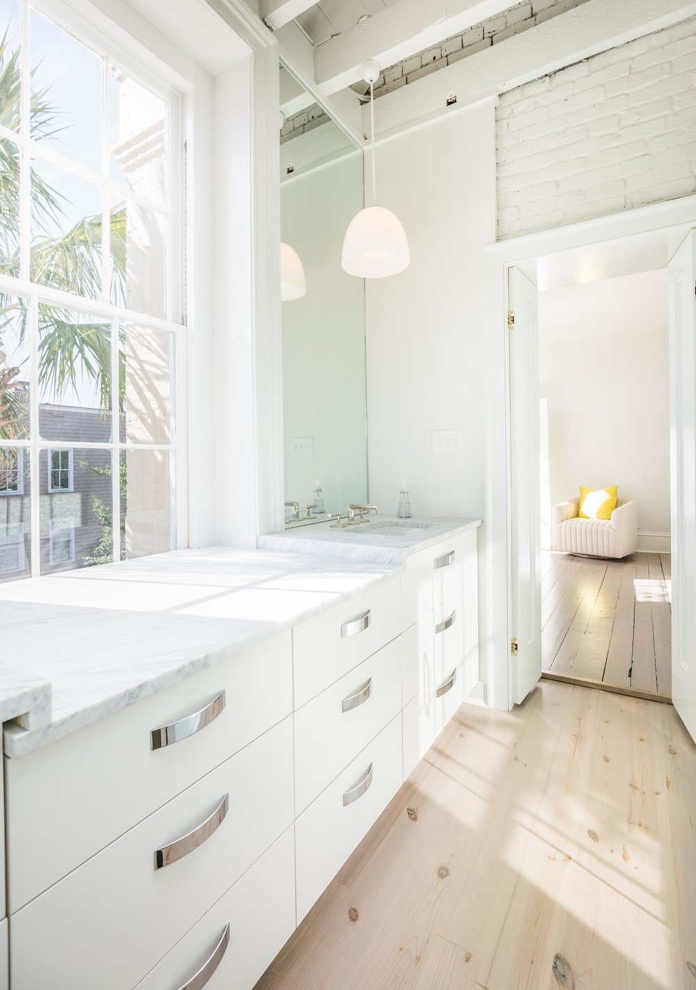 - A light-filled narrow bathroom becomes beautiful and functional with the addition of custom drawers and countertops. Photography by Ellis Creek Photography.