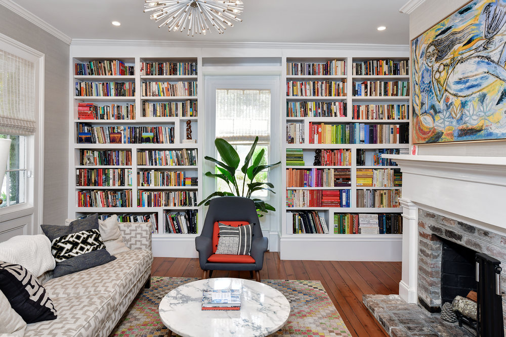 Floor-to-ceiling built-in shelves create a library wall, every book lovers dream.