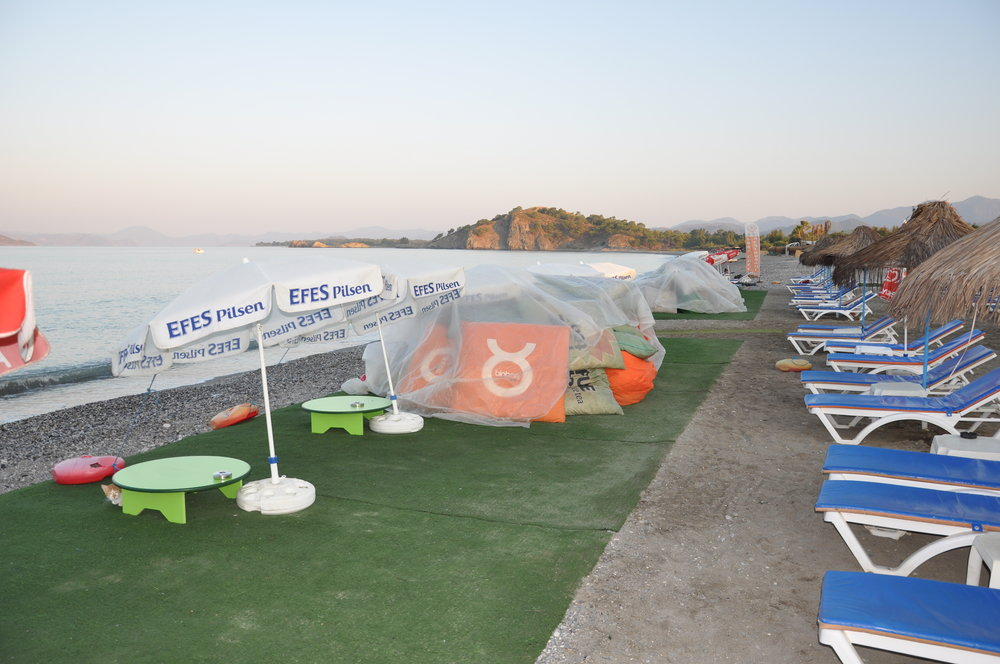 Furniture covers a sea turtle nesting beach in Calis, Fethiye, Turkey. © Medasset