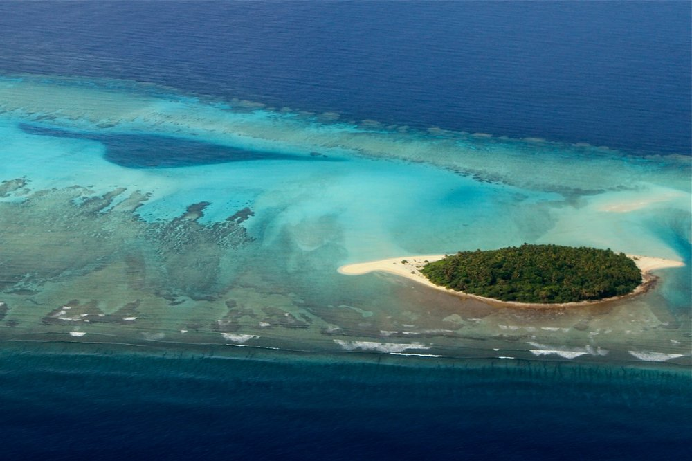 Many low lying islands are at risk of disappearing due to sea level rise. © Wayne Sentman