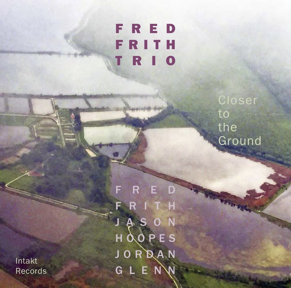 """Closer to the Ground    (2018)    ------- With their second album the Fred Frith Trio with Jason Hoopes (Bass) and Jordan Glenn (Drums) continues to explore the dimension of the guitar trio. """"Closer to the Ground"""" is all about sound, mood, texture, ideas, and atmosphere. Playful, intimate, and bound together, the Fred Frith Trio reminds us of what listening is all about. As this is also Frith's touring band, many of these themes were already road tested so even at their most in-the-moment creative, this trio remains dense and tight.      """"Three extravagantly creative musicians employed in making music like we've never heard before,"""" writes Canadian critic Raul da Gama.  """"With their previous album """"Another Day in Fucking Paradise"""", they made a brilliant debut, the second CD goes even further."""" - Karl Lippegaus,      WDR Preview Jazz       """"As an improvising soloist of the highest order, I can't imagine Frith wanting for a single thing more from his latest rhythm section – they lay down metronomic and/or shifting grooves, they create sunset-like colors on which Frith eviscerates and/or gently highlights with an array of engaging tremolo and reverberant effects, and they are acutely aware of their supporting-yet-not-passive role and play and/or don't play accordingly. Bravo to Swiss imprint Intakt Records for being home to such a vital statement from a singular artist and his inventive crew."""" - Kevin Coultas,      www.inonthecorner.com       Read further reviews / press at      Intakt"""