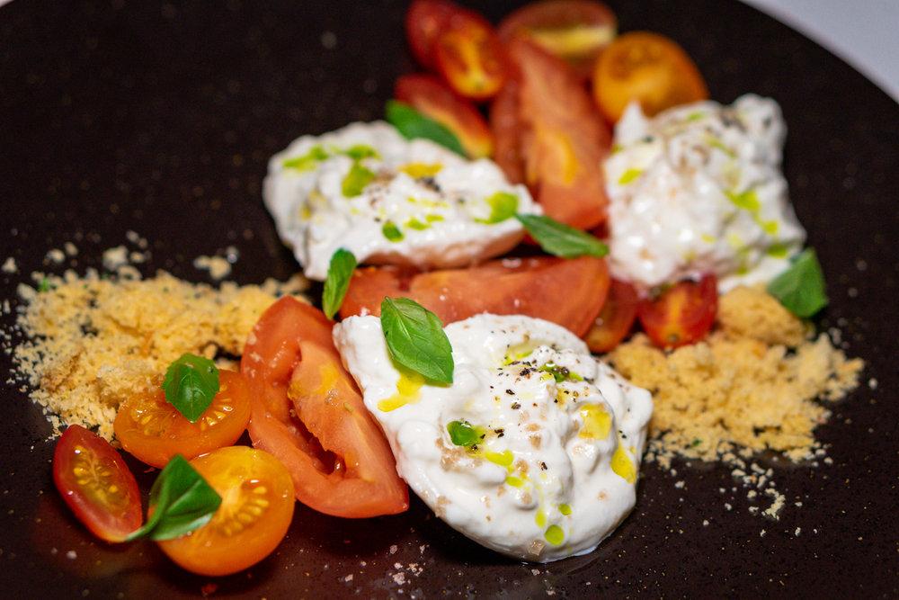 Burratina and marinated heirloom tomatoes