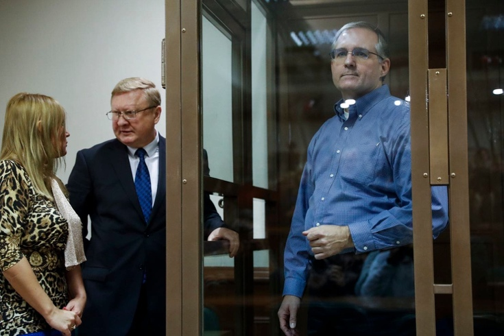 Paul Whelan, a former U.S. Marine who was arrested in Moscow at the end of last year, looks through a glass enclosure as his lawyers talk in a courtroom in Moscow on Jan. 22. (Pavel Golovkin/AP)